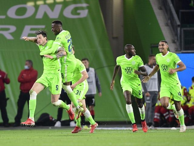 Wolfsburg's Wout Weghorst celebrates scoring their first goal with teammates on September 19, 2021