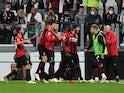 AC Milan's Ante Rebic celebrates scoring against Juventus on September 19, 2021