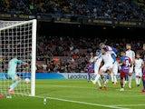 FC Barcelona's Ronald Araujo scores their first goal against Granada in La Liga on September 20, 2021
