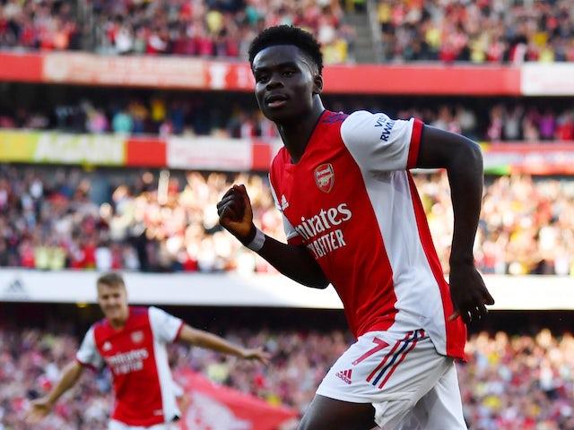 Arsenal's Bukayo Saka celebrates scoring against Tottenham Hotspur in the Premier League on September 26, 2021