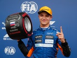 Lando Norris celebrates pole position after qualifying for the Russian Grand Prix on September 25, 2021