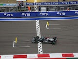 Mercedes' Lewis Hamilton crosses the line to win the Russian Grand Prix on September 26, 2021
