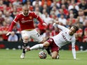 Aston Villa's Matty Cash in action with Manchester United's Luke Shaw in the Premier League on September 26, 2021
