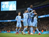 Manchester City's players celebrate after scoring against Wycombe Wanderers on September 21, 2021