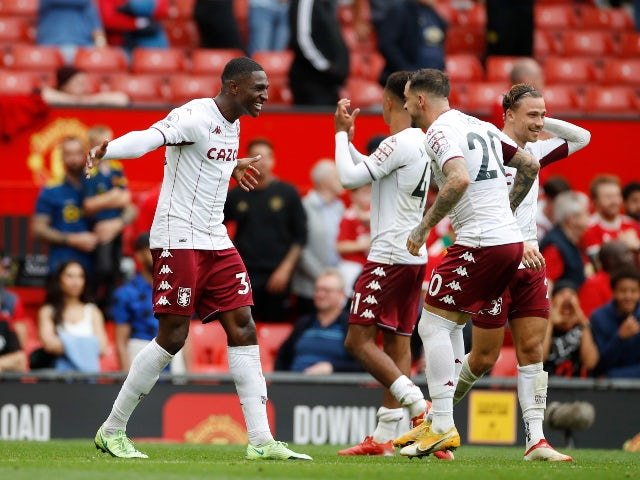 Aston Villa's Kortney Hause celebrates with Danny Ings after the match against Manchester United in the Premier League on September 25, 2021
