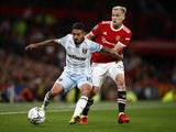 West Ham United's Manuel Lanzini in action with Manchester United's Donny van de Beek in the EFL Cup on September 22, 2021