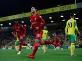 Liverpool's Takumi Minamino celebrates scoring their first goal against Norwich City in the EFL Cup on September 21, 2021