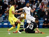 Real Madrid's Karim Benzema in action with Villarreal's Geronimo Rulli on September 25, 2021