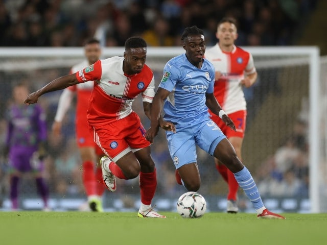 Manchester City's Romeo Lavia in action with Wycombe Wanderers' Brandon Hanlan on September 21, 2021