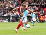 Sheffield United's Billy Sharp shoots at goal against Derby County in the Championship on September 25, 2021