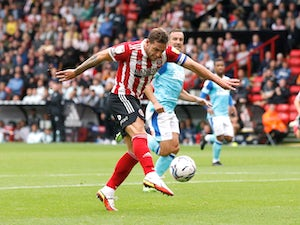 Billy Sharp seals win for Sheffield United over Derby after Kelle Roos red card