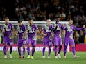 Tottenham Hotspur players celebrate their penalty-shootout win over Wolverhampton Wanderers in the EFL Cup on September 22, 2021