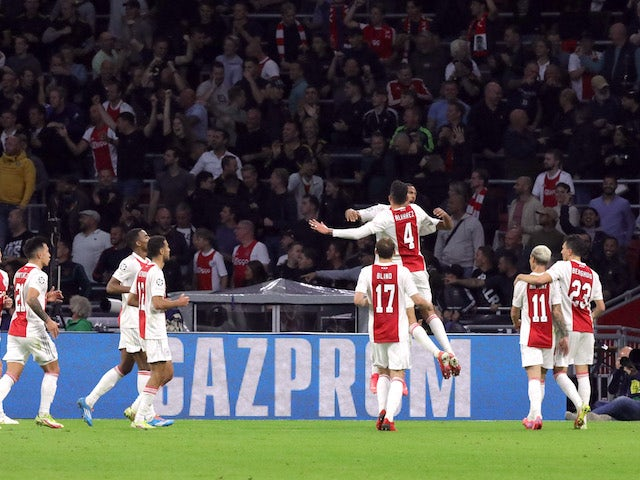 Ajax's Sebastien Haller celebrates scoring their second goal with teammates on September 28, 2021