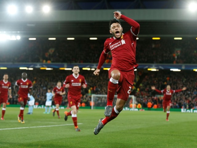 Liverpool's Alex Oxlade-Chamberlain celebrates scoring against Manchester City on April 4, 2018