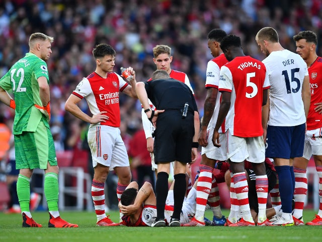 Arsenal's Granit Xhaka goes down injured against Tottenham Hotspur on September 26, 2021