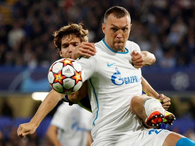 Zenit St Petersburg's Artem Dzyuba in action with Chelsea's Marcos Alonso on September 14, 2021