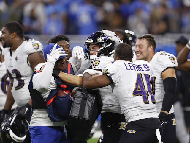 Baltimore Ravens kicker Justin Tucker (9) gets mobbed after the game against the Detroit Lions at Ford Field on September 26, 2021