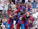 Barcelona's Ansu Fati celebrates scoring their third goal with Ronald Araujo and teammates on September 27, 2021
