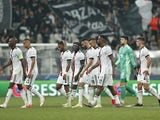 Besiktas players look dejected as they walk off at half time on September 15, 2021