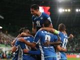 Real Betis' Nabil Fekir celebrates scoring their first goal with teammates on September 30, 2021