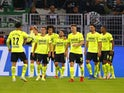 Borussia Dortmund's Donyell Malen celebrates scoring their first goal with teammates on September 28, 2021