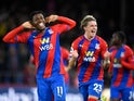 Crystal Palace's Wilfried Zaha celebrates scoring their first goal against Brighton & Hove Albion in the Premier League on September 27, 2021