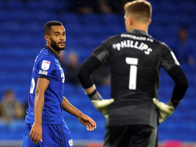 Cardiff City's Curtis Nelson reacts after scoring an own goal on September 28, 2021