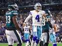 Dallas Cowboys quarterback Dak Prescott (4) celebrates a touchdown during the fourth quarter as Philadelphia Eagles defensive tackle Milton Williams (93) looks on on September 28, 2021