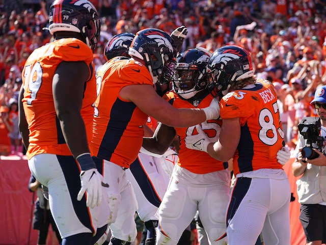 Denver Broncos running back Melvin Gordon (25) celebrates his rushing touchdown with tight end Andrew Beck (83) and offensive tackle Garett Bolles (72) in the second quarter against the New York Jets at Empower Field at Mile High on  September 26, 2021
