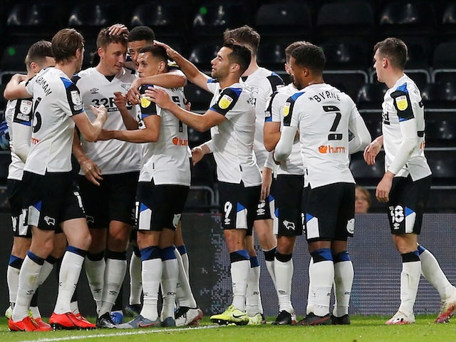 Derby County's Craig Forsyth celebrates scoring their first goal with teammates on September 29, 2021