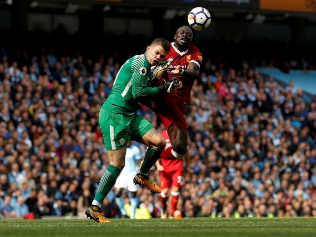 Manchester City's Ederson is fouled by Liverpool's Sadio Mane resulting in a red card on September 9, 2017