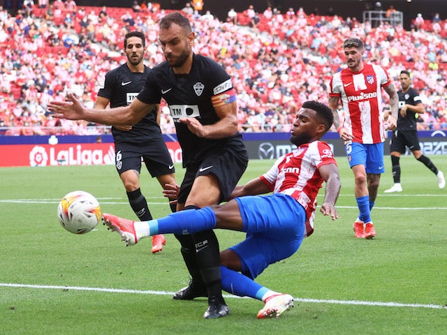 Elche's Gonzalo Verdu in action with Atletico Madrid's Thomas Lemar on August 22, 2021