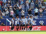 Espanyol's Raul de Tomas celebrates scoring their first goal with teammates on September 12, 2021
