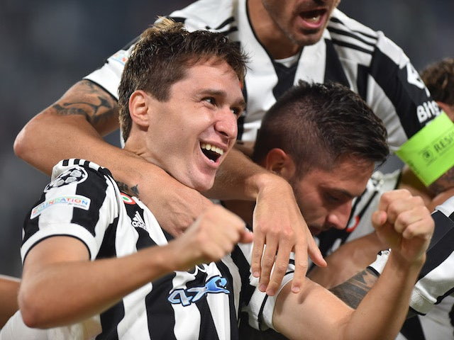 Juventus' Federico Chiesa celebrates scoring against Chelsea in the Champions League on September 29, 2021