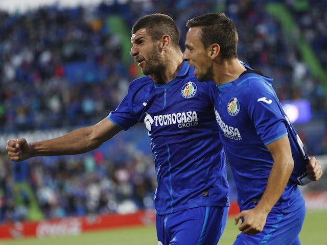 Getafe's Stefan Mitrovic celebrates scoring their first goal with Nemanja Maksimovic on September 21, 2021