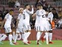 Granada's Domingos Duarte celebrates scoring their first goal with teammates on September 20, 2021