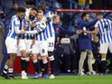 Huddersfield Town's Alex Vallejo celebrates scoring their first goal with teammates on September 28, 2021
