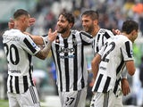 Juventus' Manuel Locatelli celebrates scoring their third goal with teammates on September 26, 2021