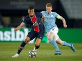 Paris St Germain's Kylian Mbappe in action with Manchester City's Kevin De Bruyne on April 28, 2021