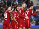 Liverpool's Mohamed Salah celebrates scoring their third goal with teammates on September 28, 2021
