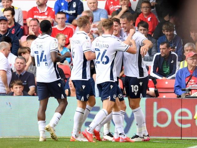 Millwall players celebrate scoring on September 25, 2021