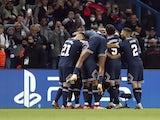 Paris Saint-Germain's (PSG) Lionel Messi celebrates scoring their second goal with teammates on September 28, 2021
