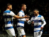 Queens Park Rangers' (QPR) Ilias Chair celebrates scoring their first goal with teammates on September 28, 2021