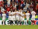Sevilla's Ivan Rakitic celebrates scoring their first goal with teammates on September 14, 2021