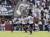 Spezia's Daniele Verde celebrates scoring their first goal with teammates on September 25, 2021