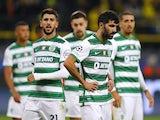 Sporting Lisbon's Luis Neto and Paulinho look dejected on September 28, 2021