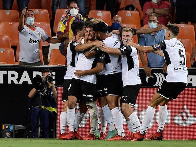 Valencia's Hugo Duro celebrates scoring their first goal with teammates on September 19, 2021