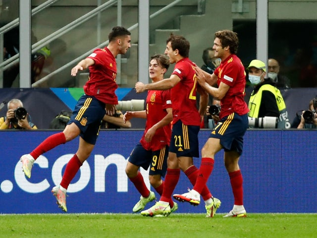 Spain's Ferran Torres celebrates scoring their first goal against Italy in the UEFA Nations League on October 6, 2021