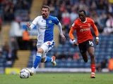 Blackburn Rovers' Joe Rothwell in action with Luton Town's Carlos Mendes Gomes on September 11, 2021