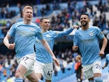 Manchester City's Kevin De Bruyne celebrates with Phil Foden and Riyad Mahrez on May 23, 2021